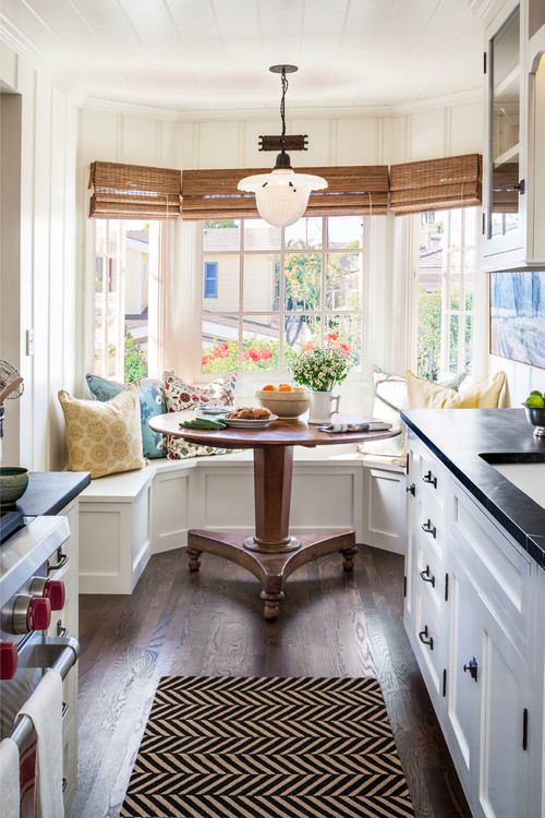 Using open shelving or glass door upper cabinets is another great way to trick the eye into thinking your kitchen is grander than it truly is.