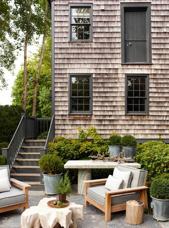 {A Side View Of The House With An Outdoor Entertaining Space}